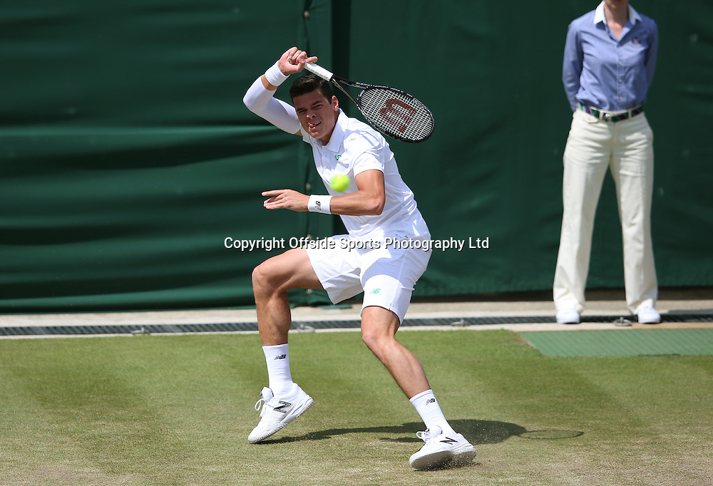 July 01 2014 Day  Eight: The Championships - Wimbledon 2014 <br /> Milos Raonic of Canada in action.<br /> Photo: Mark LeechJ