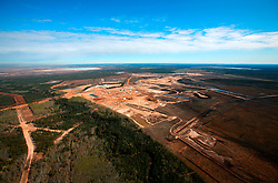 CANADA ALBERTA FORT MCMURRAY 10MAY07 - Aerial view of Shell Jackpine mine north of Fort McMurray, Alberta, Canada. The Alberta Tar Sands are the largest deposits of their kind in the world and their production is the single largest contributor to Canada's greenhouse gas emissions...Alberta's tar sands are currently estimated to contain a crude bitumen resource of 315 billion barrels, with remaining established reserves of almost 174 billion barrels, thus making Canada's oil resources ranked second largest in the world in terms of size...The industry has brought wealth and an economic boom to the region but also created an environmental disaster downstream from the Athabasca river, polluting the lakes where water and fish are contaminated. The native Indian tribes of the Mikisew, Cree, Dene and other smaller First Nations are seeing their natural habitat destroyed and are largely powerless to stop or slow down the rapid expansion of the oil sands development, Canada's number one economic driver...jre/Photo by Jiri Rezac / WWF-UK..© Jiri Rezac 2007..Contact: +44 (0) 7050 110 417.Mobile: +44 (0) 7801 337 683.Office: +44 (0) 20 8968 9635..Email: jiri@jirirezac.com.Web: www.jirirezac.com..© All images Jiri Rezac 2007 - All rights reserved.