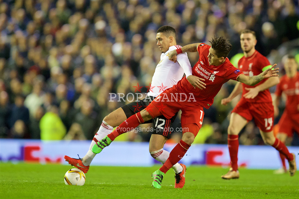 LIVERPOOL, ENGLAND - Thursday, March 10, 2016: Liverpool's Roberto Firmino in action against Manchester United's Chris Smalling during the UEFA Europa League Round of 16 1st Leg match at Anfield. (Pic by David Rawcliffe/Propaganda)