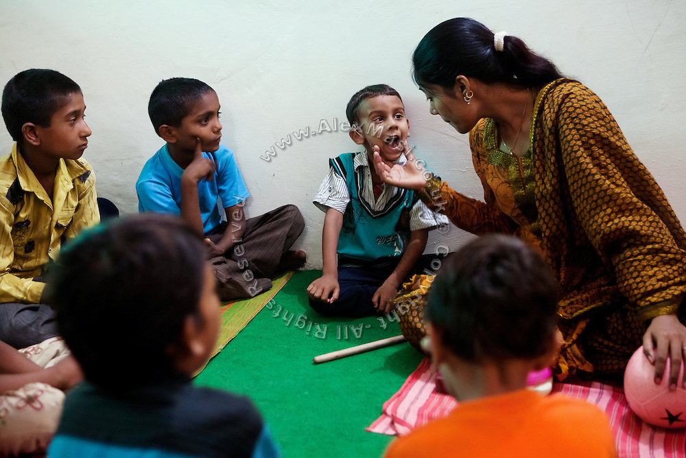 Disabled children are receiving therapy inside Chingari Trust, the local NGO caring for disabled  children in Bhopal, Madhya Pradesh, India, near the abandoned Union Carbide (now DOW Chemical) industrial complex.