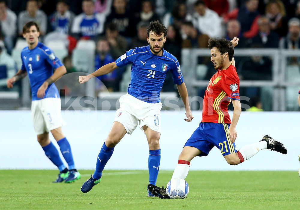 Marco Parolo of Italy and David Silva of Spain during the FIFA World Cup 2018 qualifying match between Italy and Spain at the Juventus Stadium, Turin, Italy on 6 October 2016. Photo by Matteo Ciambelli/Daimages.