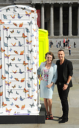 Julien Macdonald and  Esther Rantzen with  red K6 telephone boxes transformed into a variety of designs on display in Trafalgar Square in London, Friday, 15th June 2012. The ArtBox project was launched by British Telecom to mark 25 years of the charity ChildLine.  Photo by: Chris Joseph / i-Images