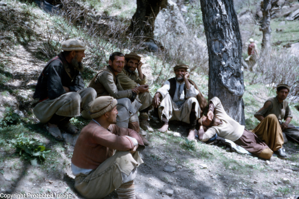 Late Summer? 1965<br /> Group of local residents seated on hillside.