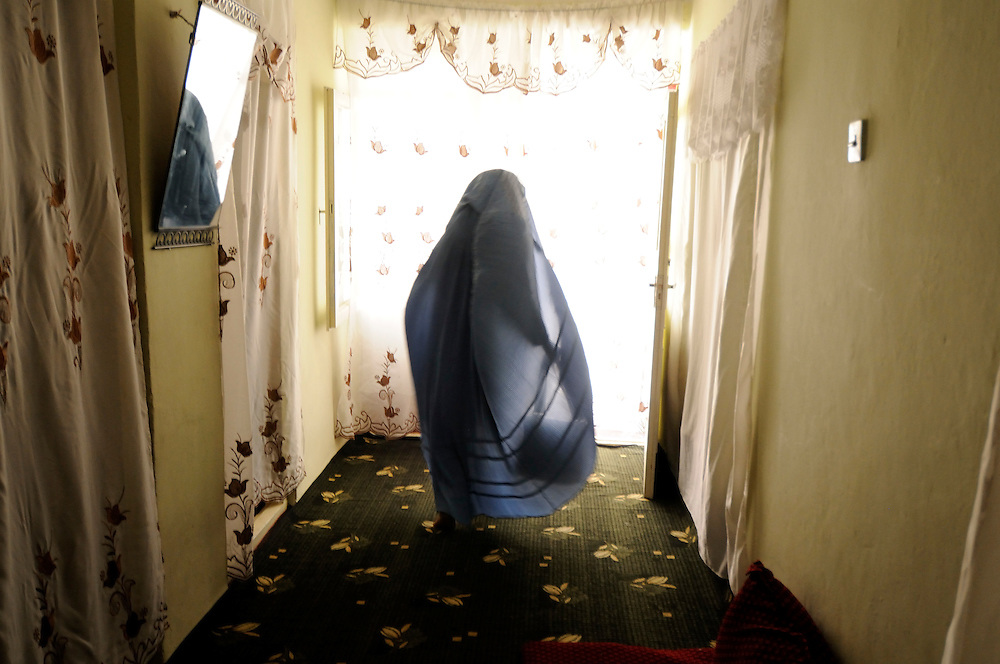 Malalai Joya wearing a burkha which she uses to conceal her identity when traveling in public.  She spends most days surrounded by supporters and armed guards in numerous safe houses in Afghanistan.  Joya electrified the nation in 2003 when she spoke out in the Afghan Parliament against warlords and criminals in the government.  She was suspended for this insult even though some fellow Parliamentarians who called for her to be raped and killed remain in government.  Joya has survived four assassination attempts and Human Rights Watch has called for her reinstatement to Parliament.