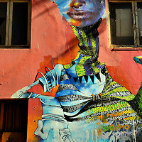 Right Detail of Stylistic Woman Street Art in Valparaíso, Chile<br />