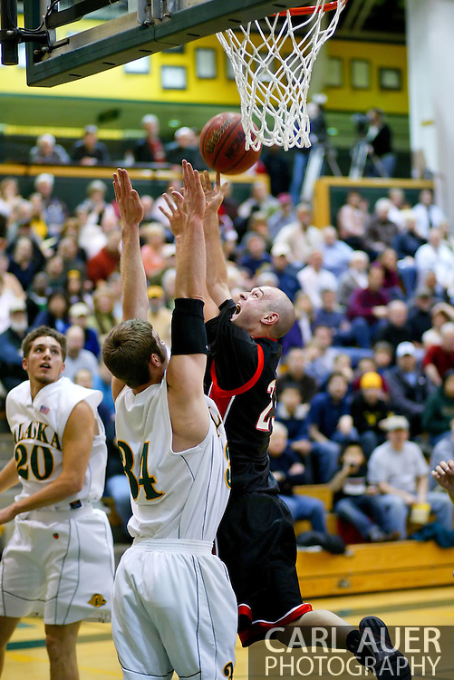 1/13/2006: Marcus Clift of the Northwest Nazarene University Crusaders goes for a rebound in the Alaska Anchorage comeback victory over Northwest Nazarene, 60-57, in men?s basketball action at the Wells Fargo Sports Complex on Saturday.