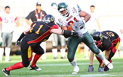 08.07.2011, Tivoli Stadion, Innsbruck, AUT, American Football WM 2011, Group A, Germany (GER) vs Mexico (MEX), im Bild Mario Nowak (Germany, #41, LB) and Matthias Eck (Germany, #26, DB) tries to stop Roldan Daniel (Mexico, #81, AC)  // during the American Football World Championship 2011 Group A game, Germany vs Mexico, at Tivoli Stadion, Innsbruck, 2011-07-08, EXPA Pictures © 2011, PhotoCredit: EXPA/ T. Haumer