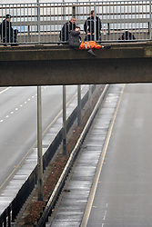 © Licensed to London News Pictures.  26/02/2013. HIGH WYCOMBE, UK. The M40 is closed since 2pm in both directions at J4 near High Wycombe following a man climbing onto a bridge overlooking the motorway. Photo credit :  Cliff Hide/LNP