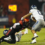 18 November 2017:  The San Diego State football team hosts Nevada Saturday night. San Diego State Aztecs cornerback Kameron Kelly (7) attempts to tackle Nevada Wolf Pack wide receiver Brendan O'Leary-Orange (17) in the first quarter. The Aztecs lead 21-14 at the half. <br /> www.sdsuaztecphotos.com