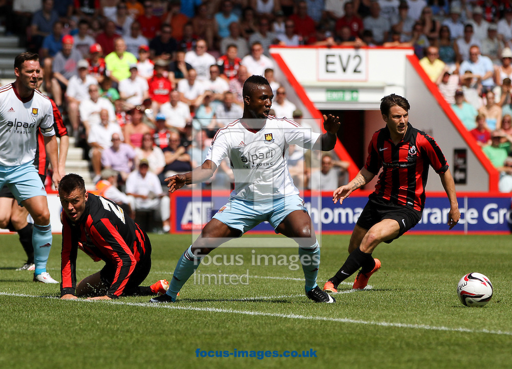 Picture by Tom Smith/Focus Images Ltd 07545141164<br /> 13/07/2013<br /> Madibo Maiga of West Ham United lunges for the ball during the Stephen Purches testimonial pre season friendly match at the Seward Stadium, Bournemouth.