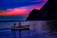 """Laying of fishing nets as the sun sets over the Gulf of Monterosso al Mare""...<br />