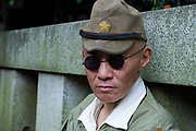 A Japanese man, wearing sunglasses, in Imperial Army uniform as Yasukuni shrine marks the 72nd anniversary of the end of the Pacific War. Yasukuni Shrine, Kudanshita, Tokyo Japan. Tuesday August 15th 2017. Nominally a event to honour Japan's war dead and call for continued peace, this annual gathering  at Tokyo's controversial Yasukuni  Shine also allows many Japanese nationalists to display their nostalgia for their Imperial past.Rightwing paramilitary groups, Imperial cos-players, politicians and many ordinary citizens come together at the shrine to march and wave flags. The day goes almost unreported in the mainstream Japanese media.