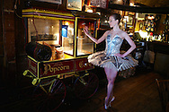 Ballerina with an old pop corn machine at the Griswold Inn. <br /> The Griswold is one of the oldest continuously operated inns in the country. It opened its doors for business in 1776.