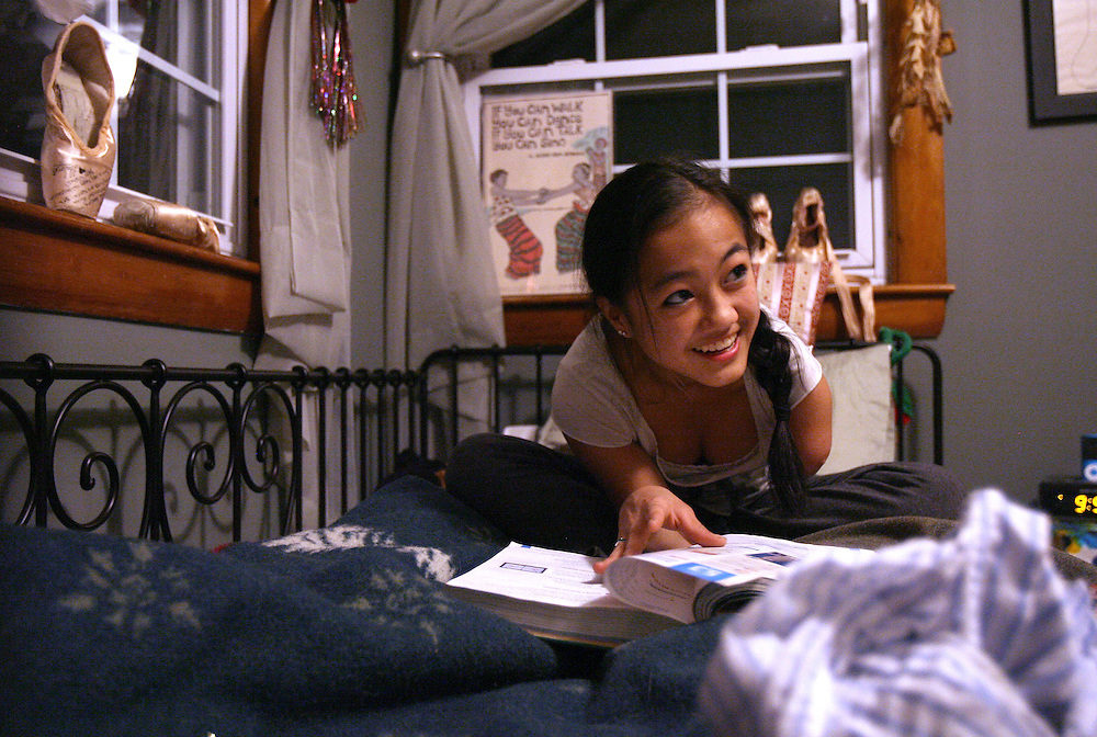 3/26/2010 Northampton, MA-  Lani Dickinson, 15, studies Algebra in her bedroom.  Lani was born in China with a congenital defect and adopted by an American family.  Despite her disability, she trains hard as a ballerina and would like to someday be a professional dancer.