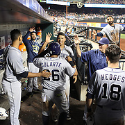 Yangervis Solarte, San Diego Padres, is congratulated by team mates in the dugout after scoring a run during the New York Mets Vs San Diego Padres MLB regular season baseball game at Citi Field, Queens, New York. USA. 29th July 2015. Photo Tim Clayton