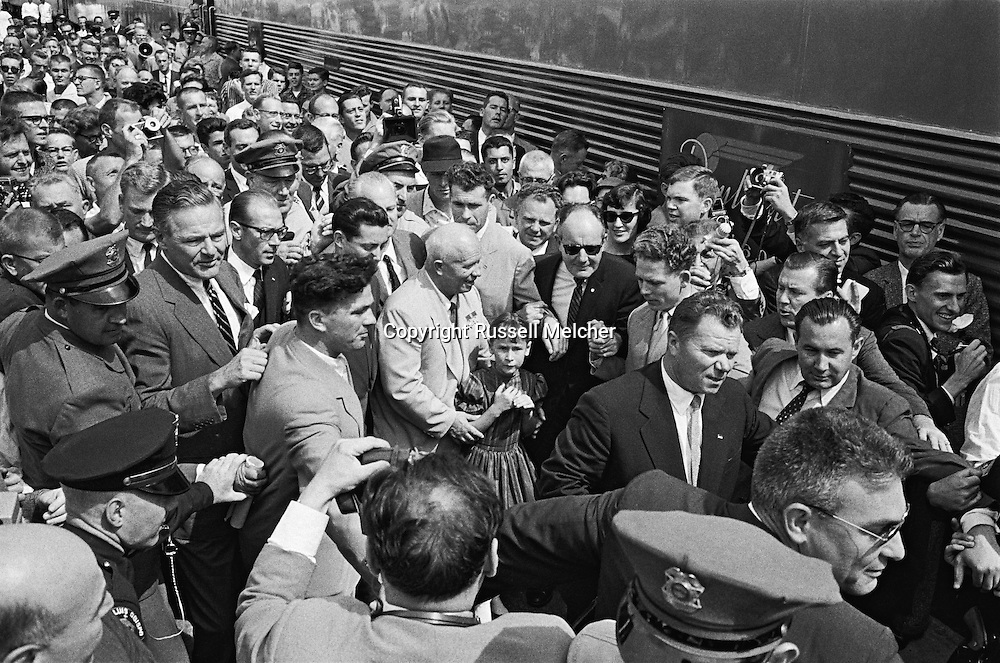 1959. On Nikita Krushchev's train trip from Los Angeles to San Francisco, Kruschev gets out of the train at San Luis Obispo and greets people applauding him, causing major problems for security. They warned the photographers that the train would leave immediately as soon as Khrushchev was on board and would not wait for anybody!!!<br />