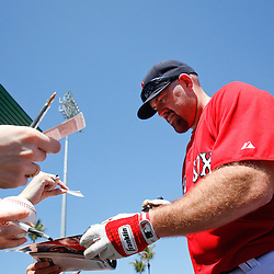 March 7, 2011; Fort Myers, FL, USA; Boston Red Sox third baseman Kevin Youkilis (20) signs autographs before a spring training exhibition game against the Baltimore Orioles at City of Palms Park.   Mandatory Credit: Derick E. Hingle