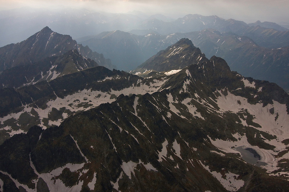 Aerial view of the massif of Mount Krivàn (2495m als), national symbol of Slovakia, with the Western Tatras on the background. High Tatras, Slovakia. June 2009. Mission: Ticha