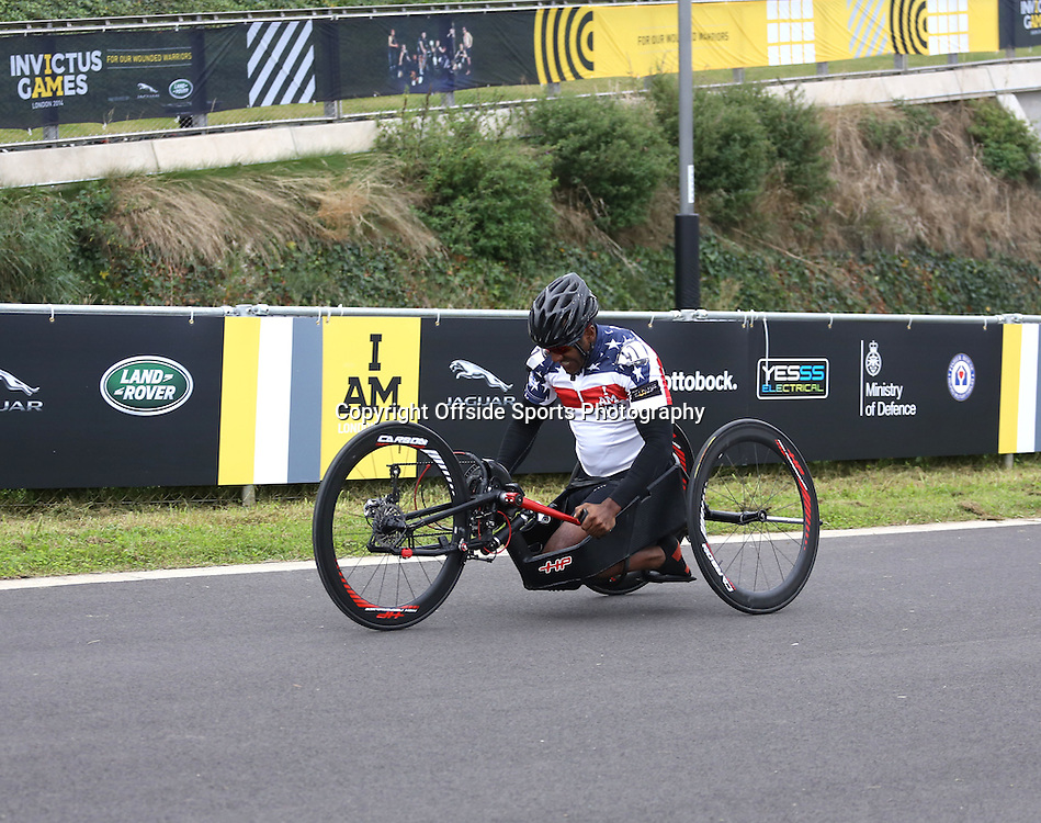 13 September 2014 - Invictus Games Day 3 - An American cyclist uses his hands to pedal with his legs tucked underneath the bike.<br /> <br /> Photo: Ryan Smyth/Offside
