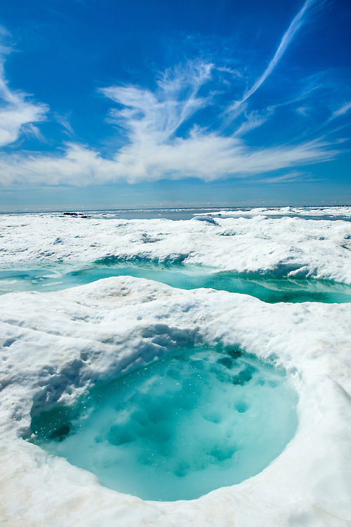 Canada, Manitoba, Churchill, Blue meltwater pool on pack ice on Hudson Bay on sunny summer afternoon