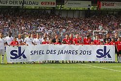 """14.06.2015, Gazi Stadion Rasenplatz, Stuttgart, GER, Das Spiel des Jahres, Sami Allstars vs Khediras Eleven, Benefizspiel, im Bild einlauden der Team mit Banner Spiel des Jahres 2015 // during """"the Game of the Year"""" charity match between Sami-Allstars and. Khediras Eleven at the Gazi Stadion Rasenplatz in Stuttgart, Germany on 2015/06/14. EXPA Pictures © 2015, PhotoCredit: EXPA/ Eibner-Pressefoto/ Langer<br /> <br /> *****ATTENTION - OUT of GER*****"""