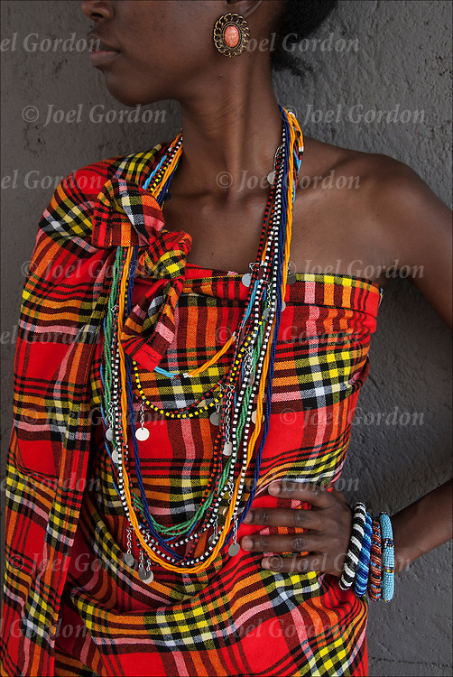 African American woman wearing traditional, crafted by hand Maasai clothing and bead work from Kenya and Tanzania .