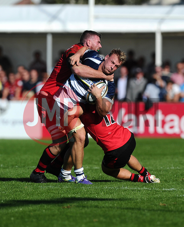 Lewis Robling of Jersey Rugby tackles Bristol Rugby Number 8 Mitch Eadie  - Mandatory byline: Joe Meredith/JMP - 07966386802 - 26/09/2015 - RUGBY - St. Peter -Saint Peter,Jersey - Jersey Rugby v Bristol Rugby - Greene King IPA Championship