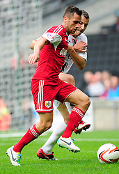 Bristol City captain, Sam Baldock jostles for the ball with Milton Keynes Dons' Antony Kay - Photo mandatory by-line: Dougie Allward/JMP - Tel: Mobile: 07966 386802 24/08/2013 - SPORT - FOOTBALL - Stadium MK - Milton Keynes -  Milton Keynes Dons V Bristol City - Sky Bet League One