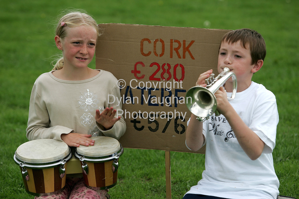 29/8/2004.Aine Whelan aged 9 from Waterford and Patrick O Carroll aged 10 from Waterford pictured at the music rally in the Peoples Park in  Waterford on Saturday as part of a protest over the the increasing of fees at the Waterford School of Music..Picture Dylan Vaughan