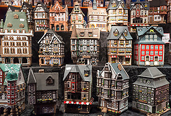 Traditional lanterns in shape of old model houses for sale on craft stall in Cologne Christmas Market in Germanyin winter Germany