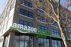 June 16, 2017 - FILE PHOTO - Amazon has acquired Whole Foods, a move that marks the e-commerce giant's official entry into the world of physical stores as well as groceries. It's Amazon's biggest acquisition ever, paying $13.7 billion in cash for the grocery chain, which now operates some 465 stores across the U.S. Amazon has grown into a retail behemoth and has has been tip-toeing into bookstores and experimental convenience stores. Those efforts led to speculation that Amazon eventually would make a major acquisition of a chain, rather than slowly build out its own stores. That acquisition ended up being Whole Foods. Pictured: March 29, 2017 - Seattle, Washington/King County, U.S. - AmazonFresh Pickup SoDo. Amazon.com revealed two grocery pickup locations in Seattle' SoDo and Ballard neighborhoods where shoppers can receive their online purchases in as little as fifteen minutes after they are placed. Customers also have the option of selecting a convenient time for pickup. AmazonFresh Pickup is currently available for Amazon employees in a beta test program. (Credit Image: © Paul Gordon via ZUMA Wire)