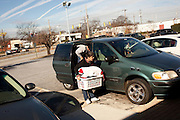 Eduardo Barajas loads clean clothes into a van after he and his father Roberto did several loads of laundry at Coin Laundry in East Point, Georgia December 30, 2009. Monica, Eduardo's mother, has been separated from her husband and son so she could continue dialysis in Mexico.