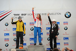 February 23, 2019 - Calgary, Alberta, Canada - Left to right: Tina Herman (Germany) - 2nd place, Elena Nikitina (Russia) - st place, and Mirela Rahneva (Canada) - 3rd place are on the stage during the medal ceremony at BMW IBSF SKELETON WORLD CUP Calgary Canada 23.02.2019 (Credit Image: © Russian Look via ZUMA Wire)