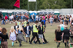 © Licensed to London News Pictures . 07/06/2015 . Manchester , UK . Security detain and remove a man at The Parklife 2015 music festival in Heaton Park , Manchester . Photo credit : Joel Goodman/LNP