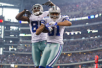 06 November 2011: Wide receiver's (81) Laurent Robinson and (88) Dez Bryant of the Dallas Cowboys celebrate after Robinson catches a touchdown against the Seattle Seahawks during the second half of the Cowboys 23-13 victory over the Seahawks at Cowboy Stadium in Arlington, TX.