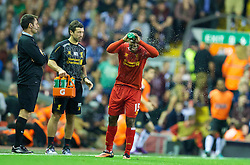 LIVERPOOL, ENGLAND - Tuesday, August 27, 2013: Liverpool's Daniel Sturridge and head of fitness and science Ryland Morgans during the Football League Cup 2nd Round match against Notts County at Anfield. (Pic by David Rawcliffe/Propaganda)