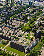 Nederland, Noord-Brabant, Eindhoven, 27-05-2013; stadsdeel Woensel-Noord, wijk Ontginning, buurt 't Hool. Boven in beeld winkelcentrum Woensel.<br /> De woonbuurt met verschillende woningtypes is tussen 1968 en 1972 gerealiseerd en geldt als toonbeeld van de wederopbouw architectuur en stedenbouw. Architect Jaap Bakema.<br /> Residential area in Eindhoven with various housing types realized between 1968 and 1972. The design is considered a model of architecture and urban reconstruction. Architect Jaap Bakema.<br /> luchtfoto (toeslag op standard tarieven)<br /> aerial photo (additional fee required)<br /> copyright foto/photo Siebe Swart