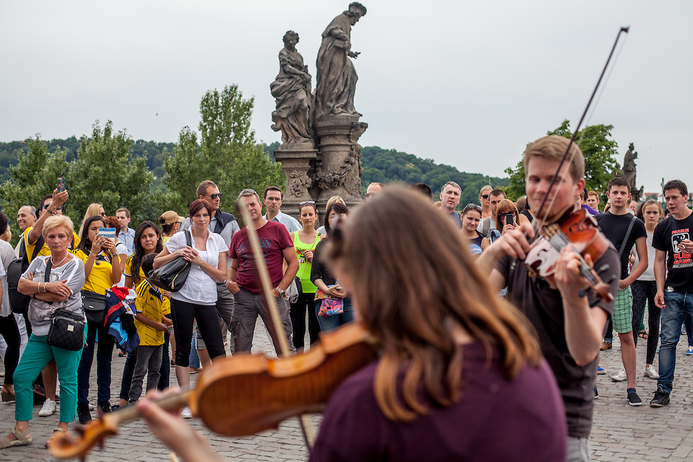 """Audience listening to the """"Electroshock""""  electric swing quartet performing at Charles Bridge. Every artist working on Charles Bridge had to go through a selection process in front of a jury to get permission to work on the bridge."""