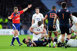 Owen Farrell of England holds his wrist in pain after suffering an injury - Mandatory byline: Patrick Khachfe/JMP - 07966 386802 - 04/02/2017 - RUGBY UNION - Twickenham Stadium - London, England - England v France - RBS Six Nations Championship 2017.