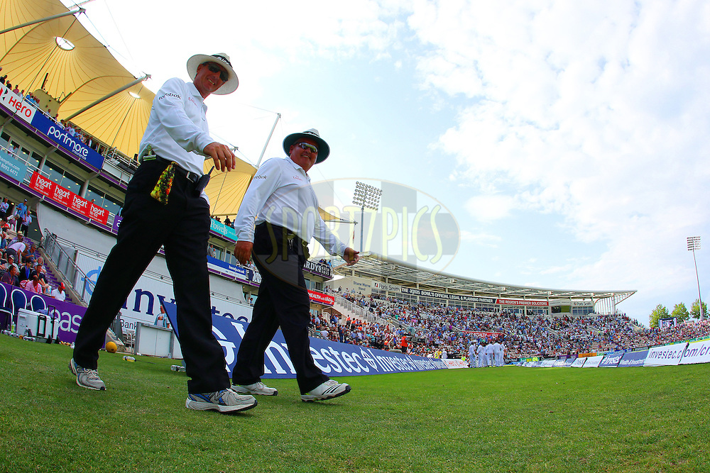 Umpires Rod Tucker and Marais Erasmus take to the field during day two of the third Investec Test Match between England and India held at The Ageas Bowl cricket ground in Southampton, England on the 28th July 2014<br /> <br /> Photo by Ron Gaunt / SPORTZPICS/ BCCI