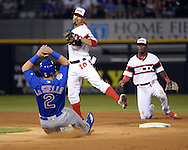 CHICAGO - JULY 26:  Tyler Saladino #18 of the Chicago White Sox turns a double play over the sliding Tommy LaStella #2 of the Chicago Cubs on July 26, 2016 at U.S. Cellular Field in Chicago, Illinois.  The White Sox defeated the Cubs 3-0.  (Photo by Ron Vesely) Subject:    Tyler Saladino; Tommy LaStella