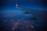 In flight Icelandair Airline Boeing 757 - 200 airplane flying evening flight in blue skies at twilight over the UK