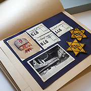 BOWIE, MD - MAY3: The scrapbook of Margaret Gruenbaum, who with her two children was imprisoned in the Theresienstadt concentration camp, is now carefully preserved at the U.S. Holocaust Memorial Museum's David and Fela Shapell Family Collections, Conservation and Research Center in Bowie, MD, May 3, 2017. The scrapbook contains almost every piece of paper that she was given during her incarceration. It also includes two yellow stars of David on cloth that she wore during the Holocaust.<br /> <br /> The 80,000-square-foot Shapell Center is a state-of-the-art facility that will house the collection of record of the Holocaust, including historical artifacts, documents, photographs, film and other objects related to the Holocaust. (Photo by Evelyn Hockstein/For The Washington Post)
