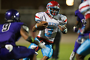 T'Marvieun Johnson (3) of the Carter Cowboys scrambles against the Lincoln Tigers during a high school football game at Forester Stadium in Dallas, Texas on September 18, 2015. (Cooper Neill/Special Contributor)