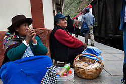 Food vendors offer their products to passengers. Common items are prickly pears, chicharron (fried pork) and corn buns.