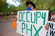 17 OCTOBER 2011 - PHOENIX, AZ:   ALEX L. an Occupy Phoenix protester at the protest in downtown Phoenix Monday morning. About 40 people spent Sunday night on the sidewalks around the Cesar Chavez Plaza in Phoenix, AZ, the defacto headquarters of the Occupy Phoenix protest. Early Monday morning they got up to continue their chants and protests against Wall Street, the growing income gap between rich and poor in the US, and money in politics. Monday marks the third day of Occupy Phoenix.   PHOTO BY JACK KURTZ