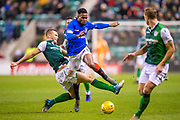 Ryan Porteous (#36) of Hibernian FC tackles Lassana Coulibaly (#23) of Rangers FC during the Ladbrokes Scottish Premiership match between Hibernian and Rangers at Easter Road, Edinburgh, Scotland on 19 December 2018.