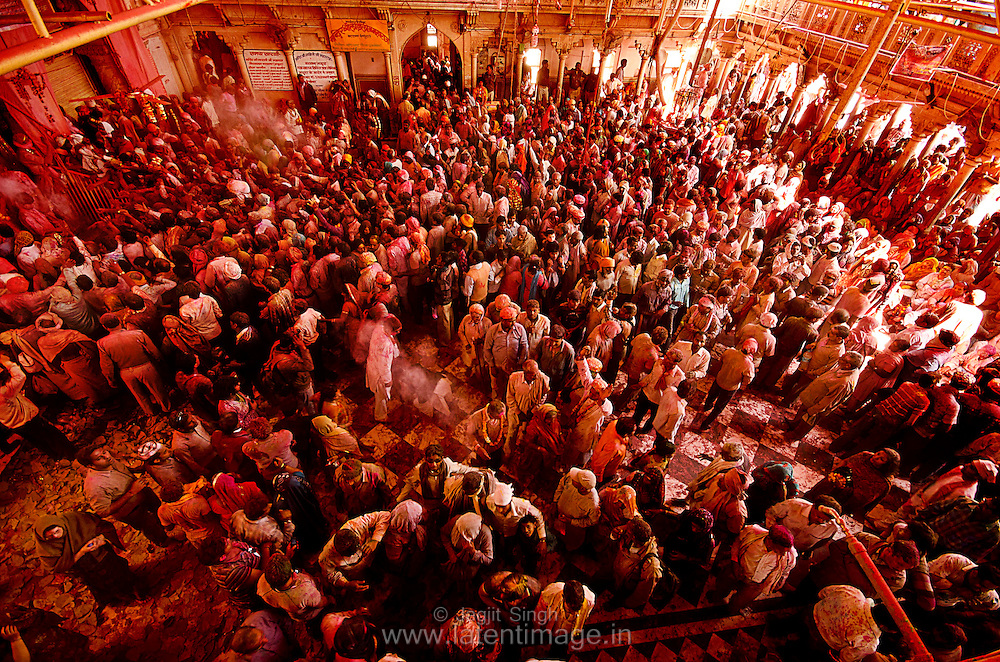 People gather inside the temple premises for the celebration. Braj ki Holi