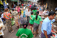 YANGON, MYANMAR - CIRCA DECEMBER 2013: People walking and wandering around the street market of Yangon.