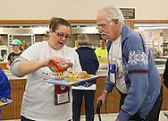 Cindy Lampe (from left), Registered Nurse at St Luke's Hospital, helps Ed Reif of Marion through the lunch line during the Retreat & Refresh Stroke Camp at Camp Courageous in Monticello on Saturday, April 20, 2013. Reif is a stroke surviver.